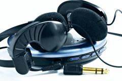 Headphones and player. A set of personal music Royalty Free Stock Photography