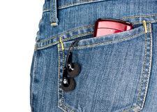 Headphones and player in the back pocket of jeans. On white background stock image