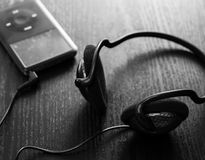 Headphones and player Royalty Free Stock Photo
