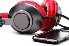 Headphones and player on a white background Stock Photography
