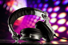 Headphones on purple background Stock Image