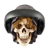 Headphones put on a ceramic skull head Stock Photography