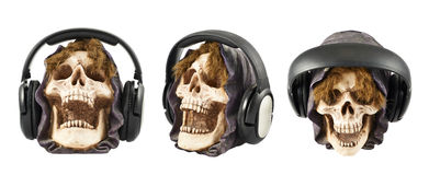 Headphones put on a ceramic skull head Royalty Free Stock Photography