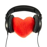Headphones put on a plush heart Stock Image