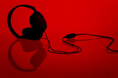 Headphones on red stock image