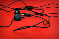 Headphones on red background Stock Images