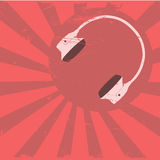 Headphones on red background Royalty Free Stock Photo