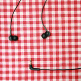 Headphones on a red bed sheet. Stock Photos