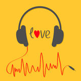 Headphones with red cord in shape of cardiogram trackline. Love card. Music icon. Black text heart. Yellow background. Royalty Free Stock Photography