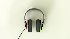 Headphones on a reflective white surface  Royalty Free Stock Images