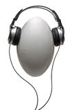 Headphones on rugby ball Royalty Free Stock Image