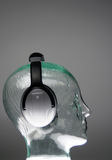 Headphones from side. Side view of headphones on glass head stock photo