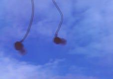 Headphones. On the sky background stock photos