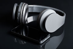 Headphones and smartphone Stock Photos