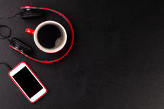 Headphones, smartphone and coffee cup Stock Images