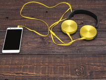 Gadgets for every day ready for their work. Headphones and smartphone - gadgets for every day Stock Images