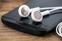 Headphones and smartphone Stock Image