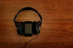 Headphones and smartphone Royalty Free Stock Photo