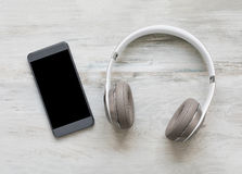 Headphones and smartphone Stock Images