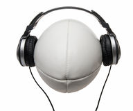 Headphones on smiling rugby ball Royalty Free Stock Image