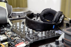 Headphones on sound mixer Stock Image