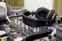 Headphones on sound mixer Stock Image