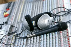 Headphones on sound mixer. Closу up of headphones on sound mixer Royalty Free Stock Photos