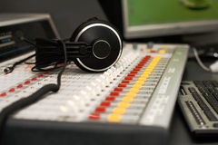 Headphones on sound mixer royalty free stock images