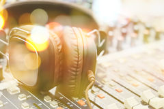 Headphones on sound mixer Royalty Free Stock Image
