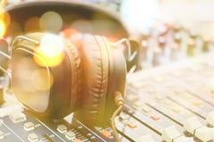 Headphones on sound mixer Royalty Free Stock Image