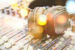 Headphones on sound mixer Stock Images