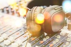 Headphones on sound mixer Stock Images