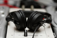 Headphones on sound mixing controller Royalty Free Stock Photography