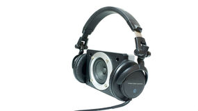 Headphones and speaker. Headphones isolated on white background Stock Photos