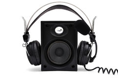 Headphones and speakers. With a microphone on a white background royalty free stock photos