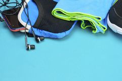 Headphones, sport bag, towel and running shoes on the sport mat. Headphones, sport bag, towel and black running shoes on the sport mat Royalty Free Stock Images