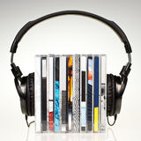 Headphones on stack of CDs Royalty Free Stock Photos