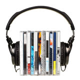 Headphones on stack of CDs Stock Images