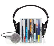 Headphones on stack of CDs. HI-Fi headphones on stack of CDs with microphone on white background Stock Photos