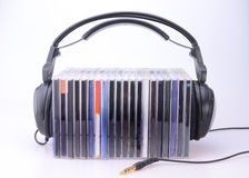 Headphones with stack of CDs Stock Image
