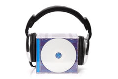 Headphones with stack of cds. Headphones with stack of compact disks Royalty Free Stock Photos
