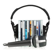 Headphones on stack of CDs with microphone Stock Photo