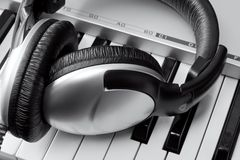 Headphones on synthesizer keyboard Royalty Free Stock Photo