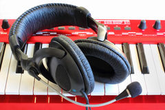 Headphones on Synthesizer Keyboard Royalty Free Stock Images