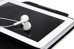 Headphones and tablet Royalty Free Stock Image