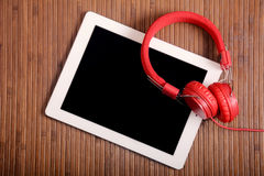 Headphones and tablet Royalty Free Stock Photo