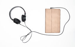 Headphones with tablet on a white background. Royalty Free Stock Photo