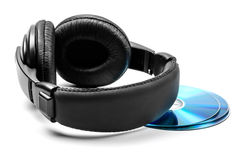 Headphones. And three disks on white background Stock Photography