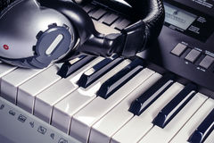 Headphones on top of a synthesizer Stock Photo