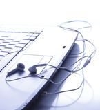 Headphones is on the touchpad Royalty Free Stock Images